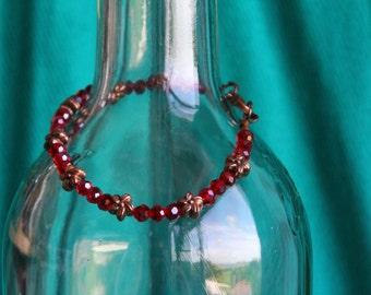 Bronze flower and ruby beaded bracelet