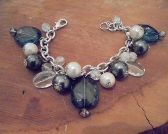 blue skwarovski jewels and mother of pearl charm bracelet.