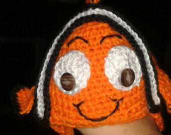 Hand crocheted Nemo from finding Nemo baby beanie with ear flaps and ties.