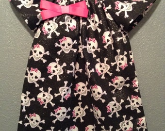 Black and pink skull dress with bow