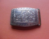 Mans sterling silver belt buckle with engraved design and place for initials-20 grams