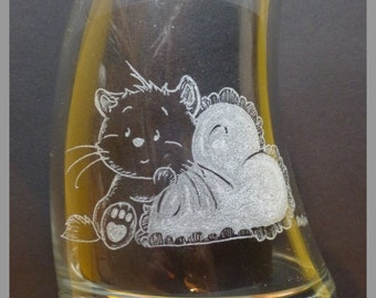 Drinking glass, cat with heart pillow