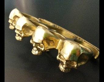 skull buster knuckle duster belt buckle