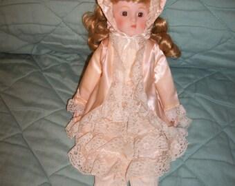 Vintage Heritage Mint Porcelain Doll Blonds Curls Peach outfit