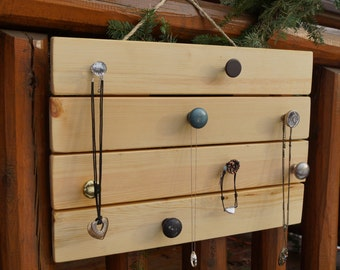 Jewelry Organizer. This rustic jewelry hanger comes with 8 distinctive knobs and a light pine finish.