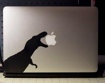 A Dinosaur (biting an apple logo? Sure.)