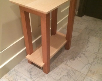 End table made of maple top and bottom shelf with mahogany legs. Great for office or small bedroom. Custom. Made to order