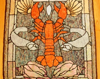 Lobster hooked rug or wall hanging. Stained glass pattern of a lobster with seashells and fish