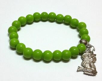 Owl in green bracelet