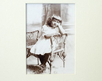 Antique photograph of girl sitting, turn of the century, vintage photo