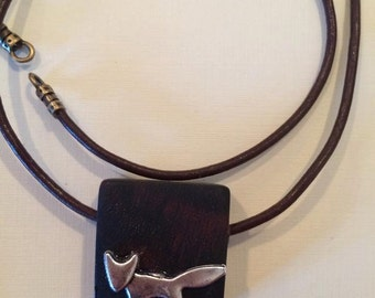 Necklace pendant with small Fox macassar ebony and leather cord.
