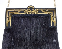 Great Gatsby Art Deco gold and black fringe evening bag, with satin lining.