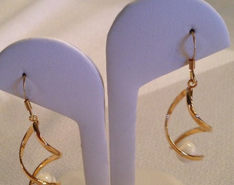 Quirky gold plated earrings with pearl