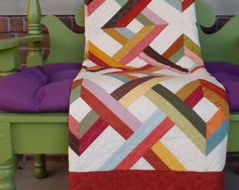 A vibrant quilt pattern full of movement and color possibilities!  Made easier with large pieced blocks and rotary cutting techniques.