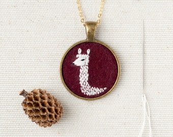 Aplaca Necklace Embroidered Felt - Circle pendant - Totem animal - Burgundy wool - Fiber jewelry - Gold plated