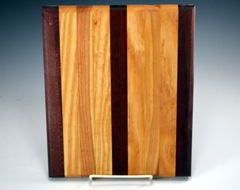 """handmade cuttingboard/chopping  trivet block made of many different woods.10 x 8.5"""".The board has jatoba, maple and mahogany and ash"""