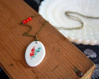 ceramic feather pendant necklace- vintage inspired- red bead detail