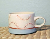 mug with half circles in red
