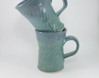 beautiful blue and green pair of mugs