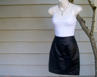 Vintage black leather mini skirt / 80s leather biker skirt / vintage black body con mini