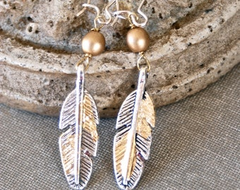 Silver and gold leafed feather earrings. Tiedupmemories