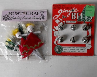 Vintage Christmas craft supplies in original packaging, jingle bell card and spun head angels, for use or display