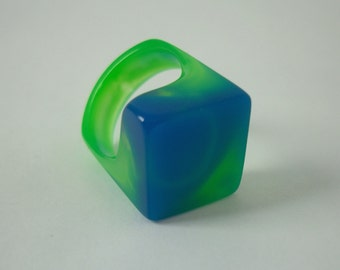 Resin ring with square top cast in blue, green and water clear. Size 6.75