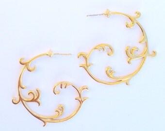 Gold curlicue hoop earrings