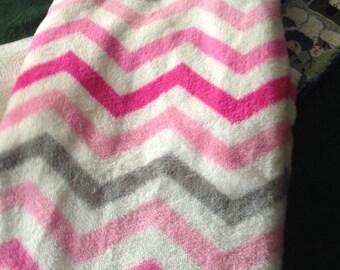Plush monogramed blanket.