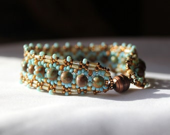Hand beaded bracelet with Natural Turquoise 6mm beads, green, bronze seed beads and Vintage Venetian matte blue beads, antique copper clasp