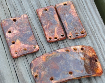SALE A GOLDMINE of Color, browns, coppers and golden tones, a 4 piece set in handmade pottery