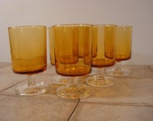 Six very nice amber glass vintage French Arcoroc glasses with clear glass stems for one price