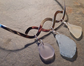 Sterling silver wave necklace with pinkish-purple, light blue, and yellow sea glass