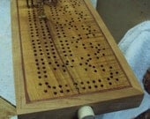 Enter the etys.com coupon ENDOFYEARBLOWOUT2015 at etsy checkout for a 50% discount! Chargino - Artisan Cribbage Board