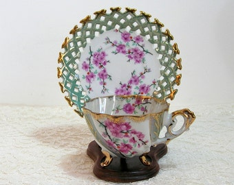Napco Pink Cherry Blossoms Design Footed Teacup With Pierced Edge Saucer