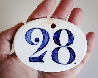 French antique ceramic number 28, originally used in winery to label wine barrels or cases