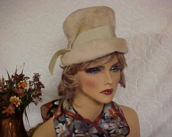 Beige imported fur cloche hat &  a beige grosgrain ribbon around the outside crown- small-fits 20-21 inches