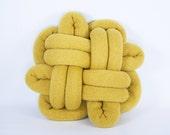 Good Luck Notknot pillow in mustard yellow