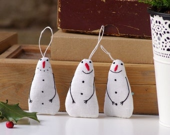 Holiday ornaments. A set of 3 snowman