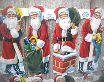 Die cut Santa page, uncut Santas, made in England, card making supply, altered art supply, holiday tag supply, die cut Santas, festive Santa