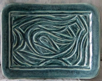 Handmade Stoneware dish with hand carved decoration glazed in teal blue