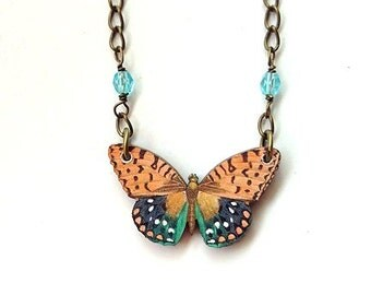 Butterfly necklace tan and teal blue wings, light blue crystal beads in chain
