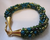Blues, Turquoise, Greens, Gold kumihimo beaded braided bracelet with gold metal hook clasp