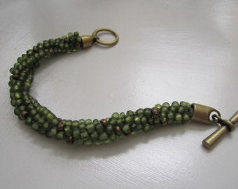 Olive Green beaded kumihimo braided bracelet with antique gold toggle clasp