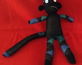 Black and Blue Argyle Sock Monkey with a worried face
