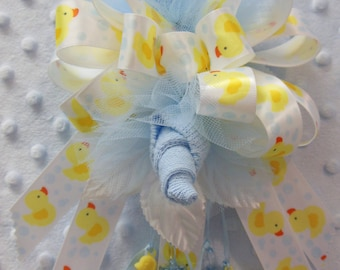 B4) Double Blue Baby Sock Corsage with 'Bath Tub Bubbles Duckies' Ribbon for Baby Shower