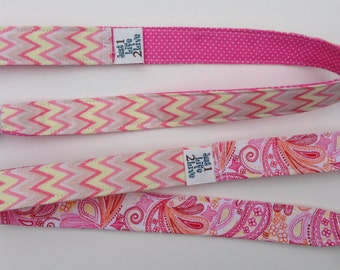 set of 2 pink and yellow chevron sippy/toy, leashes, tethers