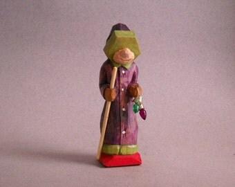 Little Santa figure in purple robe