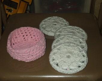 4 coasters in crocheted basket