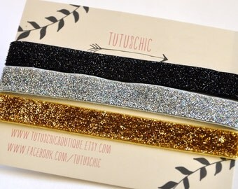 Glitter Gala stretch bands in black, silver and gold. 3 headbands in a set. TutusChic is everyday glamour.